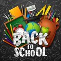 Back to School with school supplies and doodles on black chalkboard background