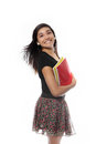 Back to school teenage girl concept pretty holding notebooks with a smile on her face Royalty Free Stock Image