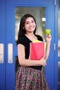 Back to school teenage girl smiling ready for with subject notebooks and a fresh green apple Royalty Free Stock Images
