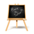 Back to school text on blackboard Stock Images