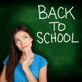 Back to school university college student teacher thinking looking up side on blackboard with written on Stock Photos