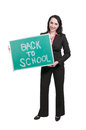 Back to school woman holding a chalkboard that says Royalty Free Stock Images