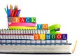Back to School wooden toy blocks on books with school supplies Royalty Free Stock Photo