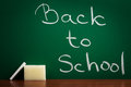 Back to school written on the blackboard Stock Photo