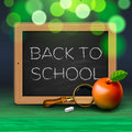 Back to school written on blackboard with chalk Royalty Free Stock Photography
