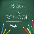 Back to school written on blackboard with chalk illustration form background Royalty Free Stock Photos