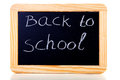 Back to school written on blackboard slate Stock Photo