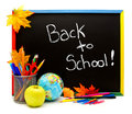 Back to school written on a blackboard with supplies Royalty Free Stock Photos