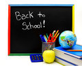 Back to school written on a blackboard with supplies Stock Images
