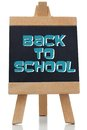 Back to school written in blue on chalkboard against white background Stock Photography