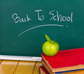 Back to school written on chalkboard. Stock Photo