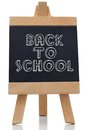 Back to school written on chalkboard against white background Stock Photo