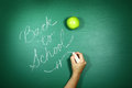 Back to school written on a chalkboard message of Royalty Free Stock Photo