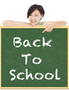 Back to school, young student girl point to blackboard Royalty Free Stock Photo