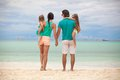 Back view of beautiful family with two daughters at exotic beach on sunny day this image has attached release Royalty Free Stock Photography