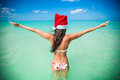 Back view of beautiful girl in santa hat walking like a bird this image has attached release Stock Photography