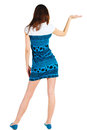 Back view of Beautiful woman in blue dress Stock Photo