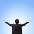 Back view of business man arms up Royalty Free Stock Photo