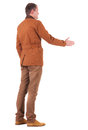 Back view of business man in jacket out to shake hands. Royalty Free Stock Photo