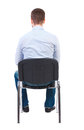 Back view of business man sitting on chair. Royalty Free Stock Photo