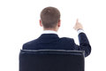Back view of business man sitting on office chair and pointing a at something isolated white background Royalty Free Stock Photo