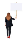 Back view business woman showing sign board young redhead girl holds information plate rear people collection backside Royalty Free Stock Image