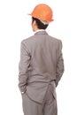 Back view of businessman in orange builder's helmet