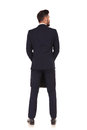 Back view of a businessman with suitcase looking to side Royalty Free Stock Photo
