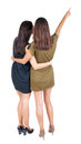 Back view of businessteam two young business women pointing rear people collection backside person isolated over Royalty Free Stock Photography