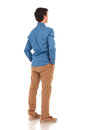Back view of a casual man with hands in pockets