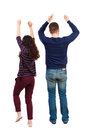 Back view of dancing young couple men and women . Dance party. Royalty Free Stock Photo