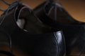 Back view detail of a pair of classic black leather shoes Royalty Free Stock Photo