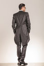 Back view of a elegant business man walking Royalty Free Stock Photo