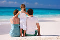 Back view family tropical beach Royalty Free Stock Images