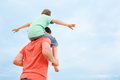 Back view father carrying his son shoulders Royalty Free Stock Image