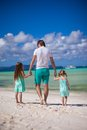 Back view of father and his two little daughters walking by the sea this image has attached release Royalty Free Stock Photo