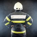 Back view of a fireman in protective suit wearing helmet Royalty Free Stock Photography