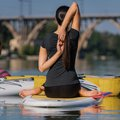 Sup yoga training Royalty Free Stock Photo