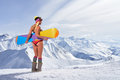 Back view of girl in bikini holding snowboard above head Royalty Free Stock Photo