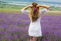 Back view of girl at purple lavender field Royalty Free Stock Photo