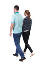 Back view going couple walking friendly girl and guy holding hands rear people collection backside of person isolated Stock Photos