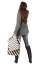 Back view of going  woman  in  coat woman with shopping bags Royalty Free Stock Photography