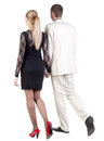 Back view of going young business couple Stock Images