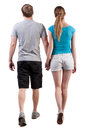Back view going young couple man woman walking beautiful friendly girl guy shorts together rear view people collection husband Stock Photography