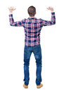 Back view of handsome man in checkered shirt keep on ha hand standing young guy jeans rear people collection backside Stock Photography