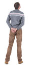 Back view of handsome man in sweater and jeans  looking up. Royalty Free Stock Image