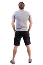 Back view handsome man t shirt shorts looking up standing young tourist rear view people collection backside view person isolated Stock Photography