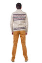 Back view of handsome man in warm sweater looking up standing young guy jeans rear people collection backside Royalty Free Stock Photo