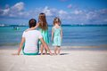 Back view of happy father with his two daughters on tropical beach vacation this image has attached release Royalty Free Stock Photos