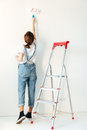 Back view image of lady in new flat make repair. Royalty Free Stock Photo